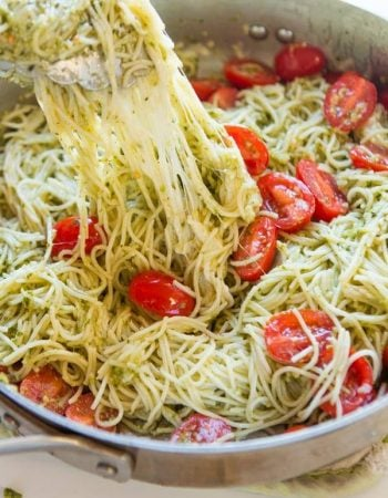 Need dinner on the table in 20 minutes? We've got a 20 minute cheesy pesto pasta recipe that's quick and easy to make and it's a great special diets recipe. ohsweetbasil.com