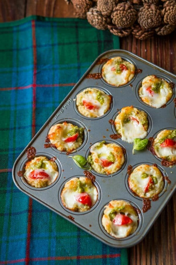 I don't know about you, but I adore appetizers, especially around the holidays. We make these 20 minute cheesy pesto tarts all the time! ohsweetbasil.com