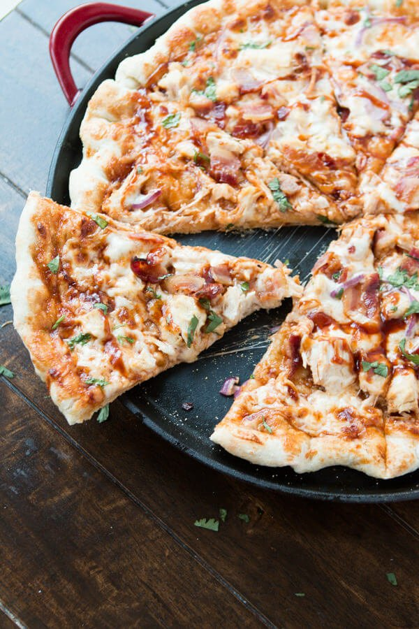 We love this copycat recipe!! Copycat California Pizza Kitchen BBQ Chicken Bacon Pizza ohsweetbasil.com