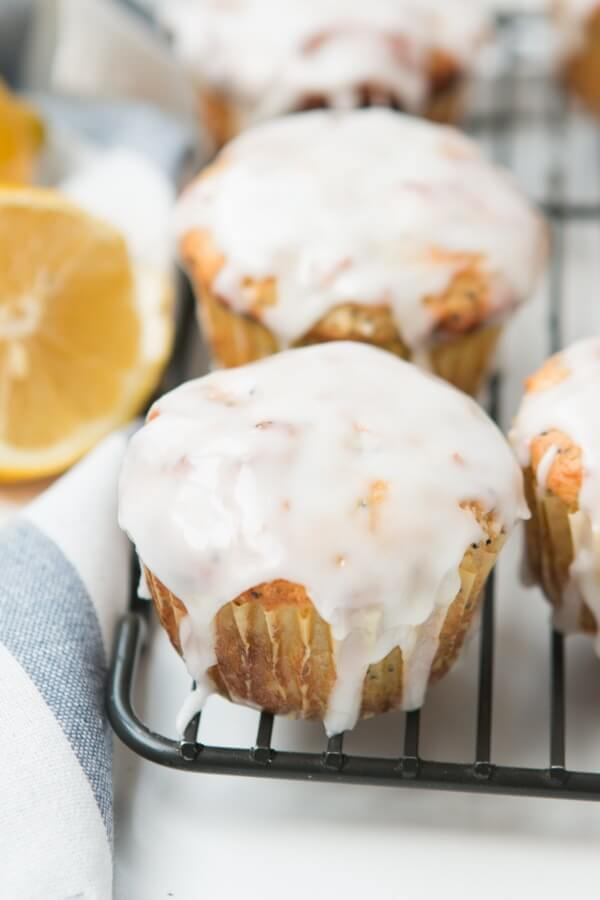 lemon poppy seed muffins topped with glaze