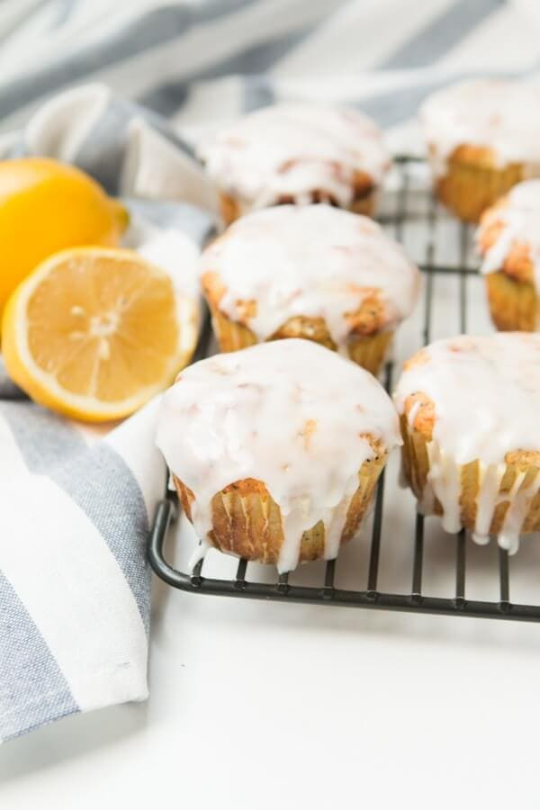 glazed lemon poppy seed muffins cooling on wire rack