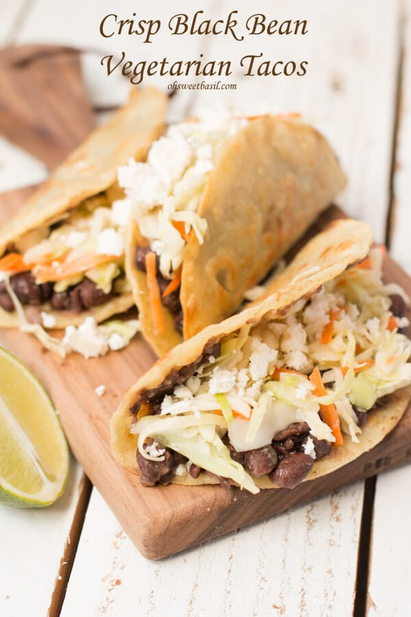 Crisp Black Bean Vegetarian Tacos. Everything I normally wouldn't love and yet these are one of our favorite tacos ever! #vegetarian #tacotuesday ohsweetbasil.com