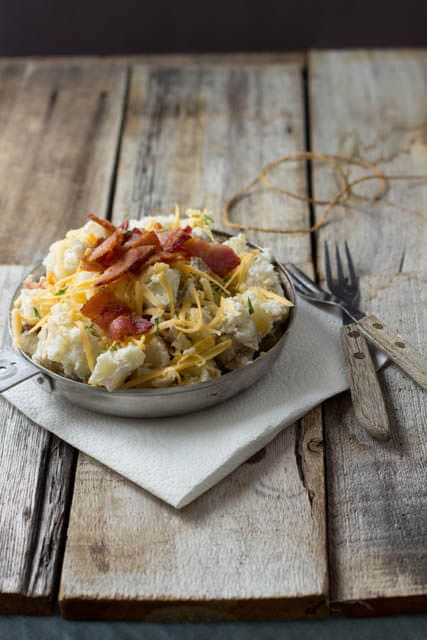 This potato salad is one of our family's summer favorites. Loaded baked potato salad with cheese, bacon and green onions. Holy delicious. ohsweetbasil.com_-2