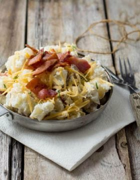 This potato salad is one of our family's summer favorites. Baked potato salad with cheese, bacon and green onions. Holy delicious. ohsweetbasil.com_-2