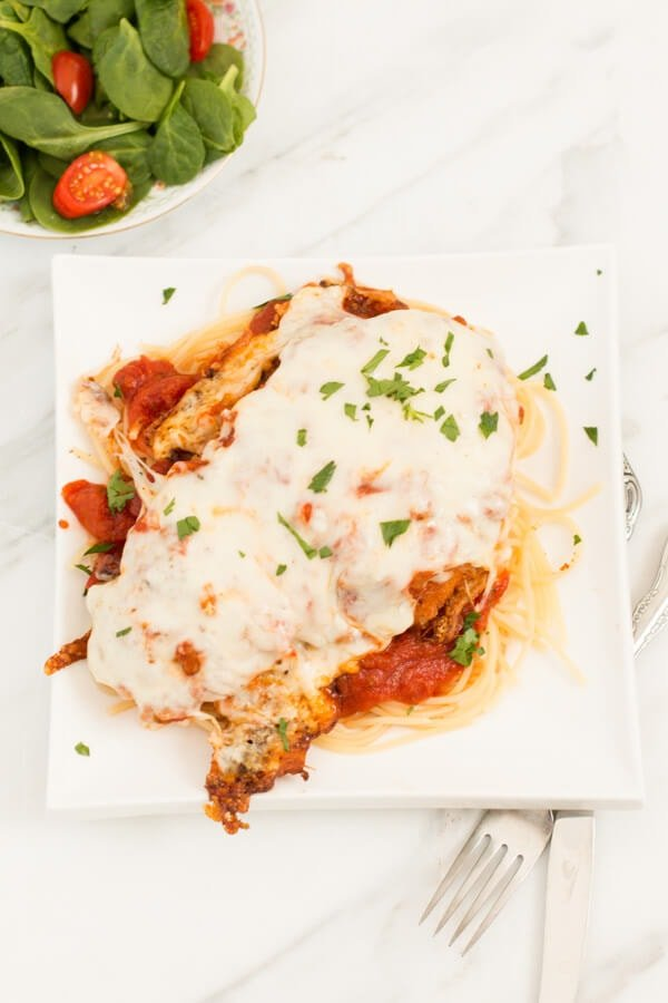 quick and easy chicken parmesan on ohsweetbasil.com. Our go-to recipe