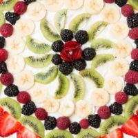 Fruit pizza with a soft sugar cookie crust ohsweetbasil.com