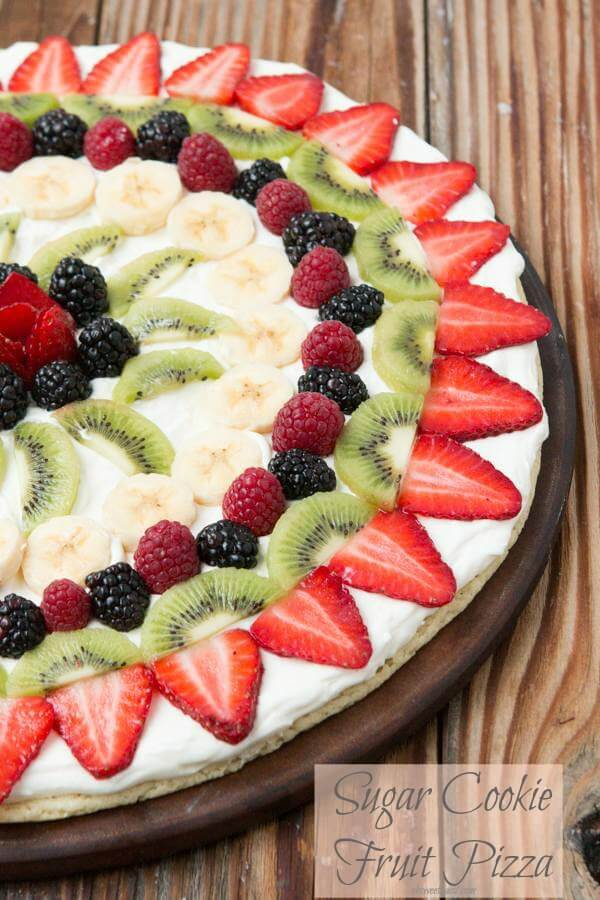 Fruit pizza with a soft sugar cookie crust ohsweetbasil.com Fruit pizza, the quick way