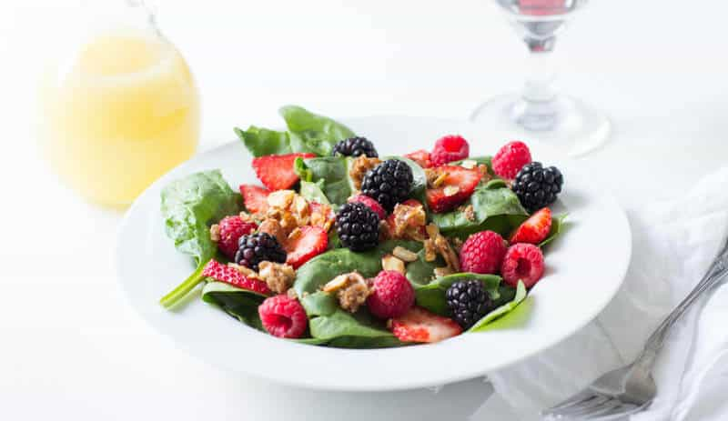 Berry salad with Lemon dressing. It seems so simple but then when you get that perfect bite with spinach, berry, and brown sugar almonds, a light lemon dressing, good mercy! ohsweetbasil.com
