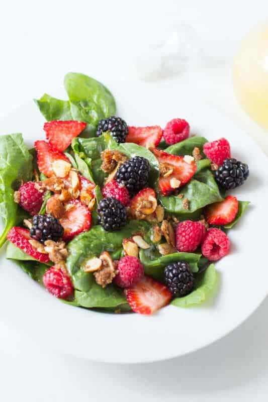 Our favorite #salad #recipe ever! It seems so simple but then when you get that perfect bite with spinach, berry, and brown sugar almonds, a light lemon dressing, good mercy! ohsweetbasil.com