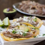 Juicy pork carnitas tacos are simply made in a crockpot with just a few ingredients that everyone has on hand and they turn out perfect every time! ohsweetbasil.com