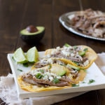 Juicy pork carnitas tacos are simply made in a crockpot with just a few ingredients that everyone has on hand and they turn out perfect every time! ohsweetbasil.com_-2