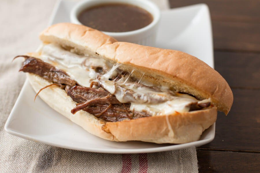 crockpot french dip sandwich on white plate
