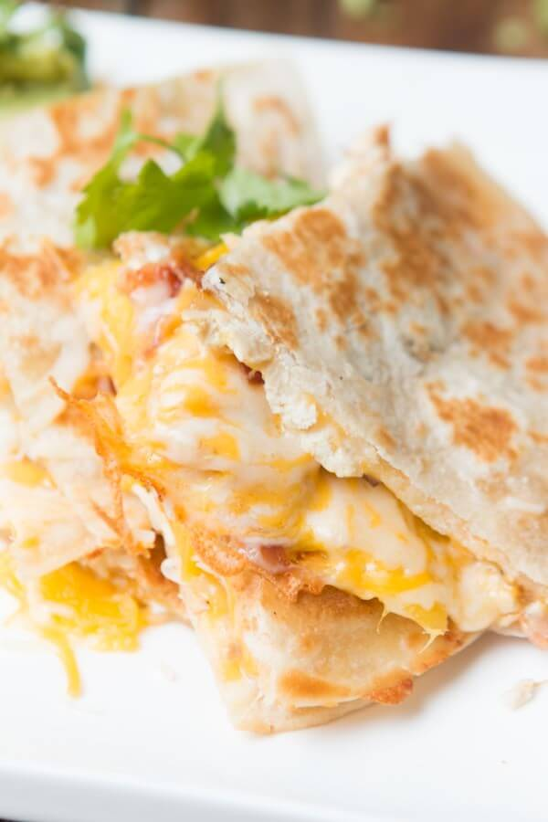 Mango Chicken Bacon Quesadillas are a little bit sweet, salty, spicy and cheesy ohsweetbasil.com