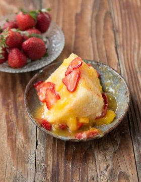 A really light and craveable dessert, angel food cake with fresh mango sauce ohsweetbasil.com