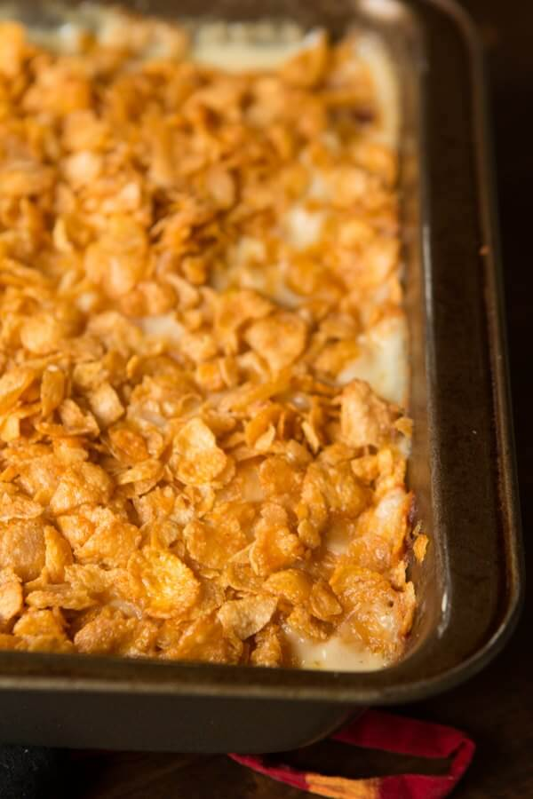 Cheesy Potato Casserole with Corn Flake topping (we call them funeral potatoes haha) ohsweetbasil.com