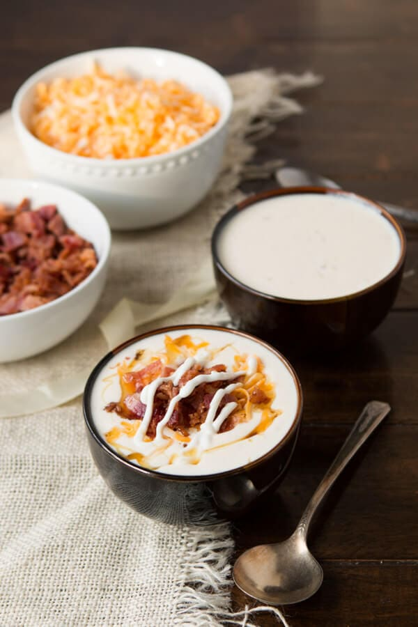 golden loaded baked potato soup is the best potato soup recipe ever! And you wont guess the secret ingredient! ohsweetbasil.com
