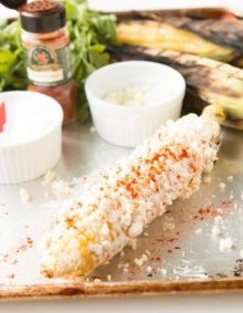 Mexican Street Corn - Elote on a baking sheet.