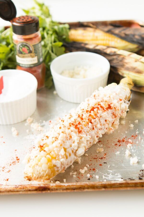 Mexican Street Corn with Cotija Cheese on a platter.