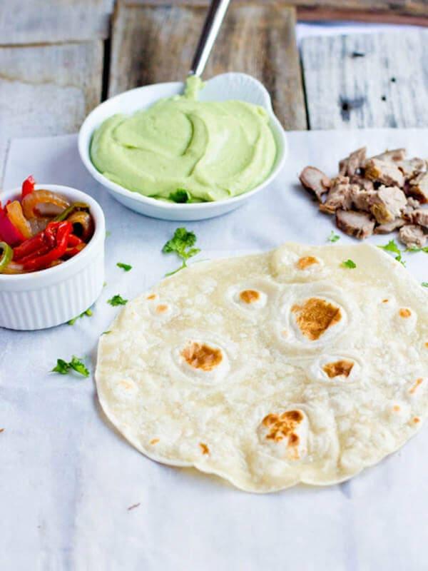 Carne asada enchiladas with the best avocado crema enchilada sauce ever. EV-ER. ohsweetbasil.com
