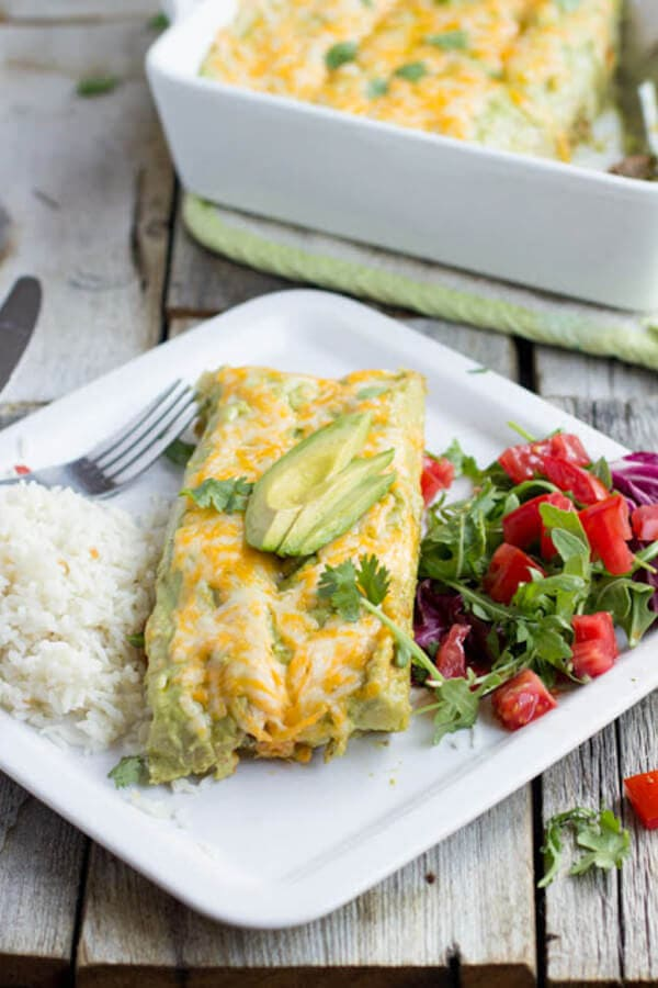 Carne asada enchiladas with the best avocado crema enchilada sauce ever. EV-ER. ohsweetbasil.com_