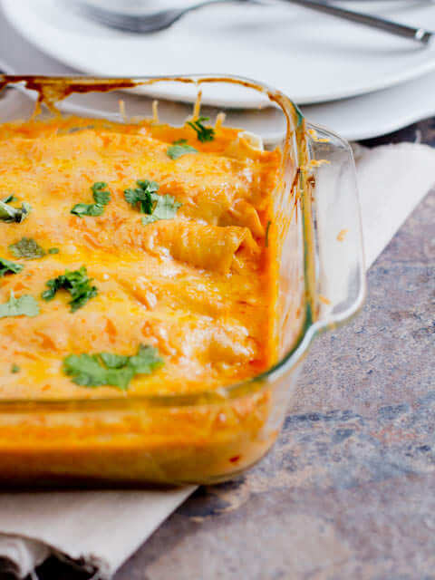 Bean and cheese smothered enchiladas ohsweetbasil.com