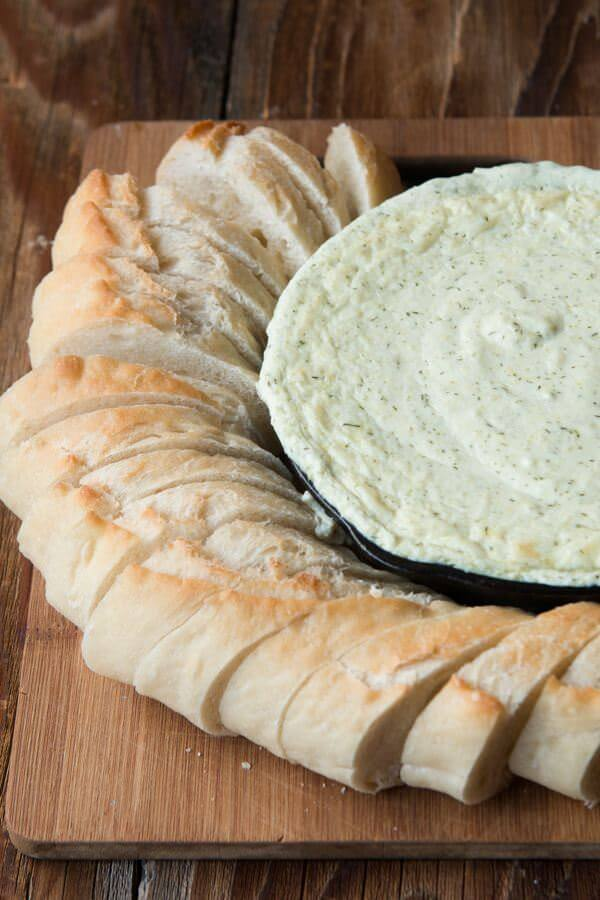 This is the best creamy artichoke dip we've ever had, at home or in a restaurant. Plus, it's super easy and can be made in the oven or slow cooker. crock-pot, pressure cooker, insta pot
