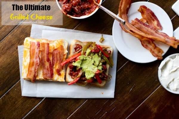 The ultimate grilled cheese is loaded with a special Manwich sauce, bacon, guacamole, caramelized onions, peppers, and gooey cheese