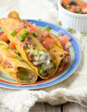 7layerdip taquitos are stuffed with beans, sour cream, guacamole, and cheese and then fried to perfection and served with fresh pico. #marchmadness ohsweetbasil.com-7