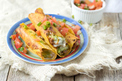 #7layerdip taquitos are stuffed with beans, sour cream, guacamole, and cheese and then fried to perfection and served with fresh pico. #marchmadness ohsweetbasil.com-7
