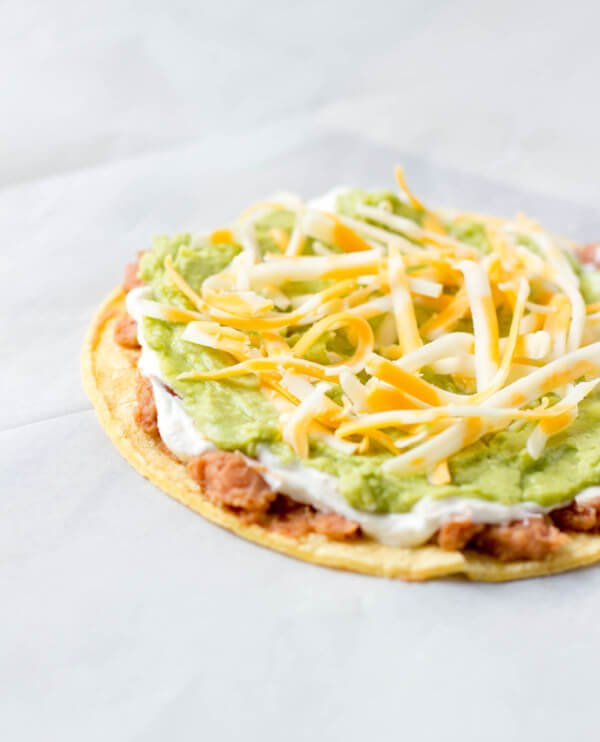 #7layerdip taquitos are stuffed with beans, sour cream, guacamole, and cheese and then fried to perfection and served with fresh pico. #marchmadness ohsweetbasil.com