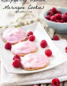 These gooey raspberry lemon meringue cookies have a few secrets, starting with what's in the middle hidden under all of that delicious raspberry glaze.