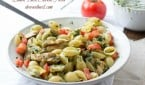 Quick and easy pasta that comes together in under 30 min with a lemon basil dressing and fresh tomatoes ohsweetbasil.com