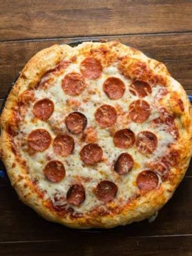 Want the perfect recipe for pepperoni Pizza that tastes as good as your favorite takeout- Click through! ohsweetbasil.com