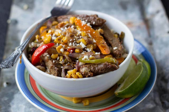 Grilled Steak, fajita rice and grilled veggies all piled up in a delicious dinner ohsweetbasil.com_