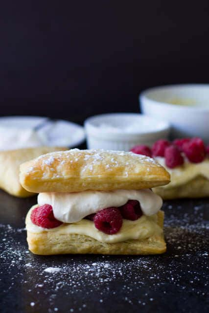 Is there anything more delicious than #lemoncurd, #raspberries and puff pastry- We could not stop eating this stuff! Lemon Raspberry Napoleons are seriously to die for! ohsweetbasil.com_-5
