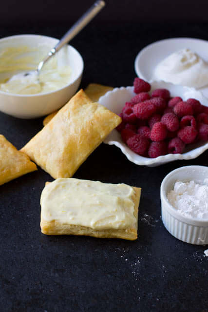 Is there anything more delicious than #lemoncurd, #raspberries and puff pastry- We could not stop eating this stuff! Lemon Raspberry Napoleons are seriously to die for! ohsweetbasil.com