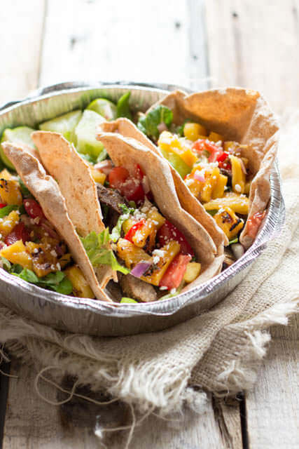 Who needs Mexico-! These Steak Tacos with Grilled Pineapple Salsa are so dang good you'll think you're in Cabo San Lucas ohsweetbasil.com