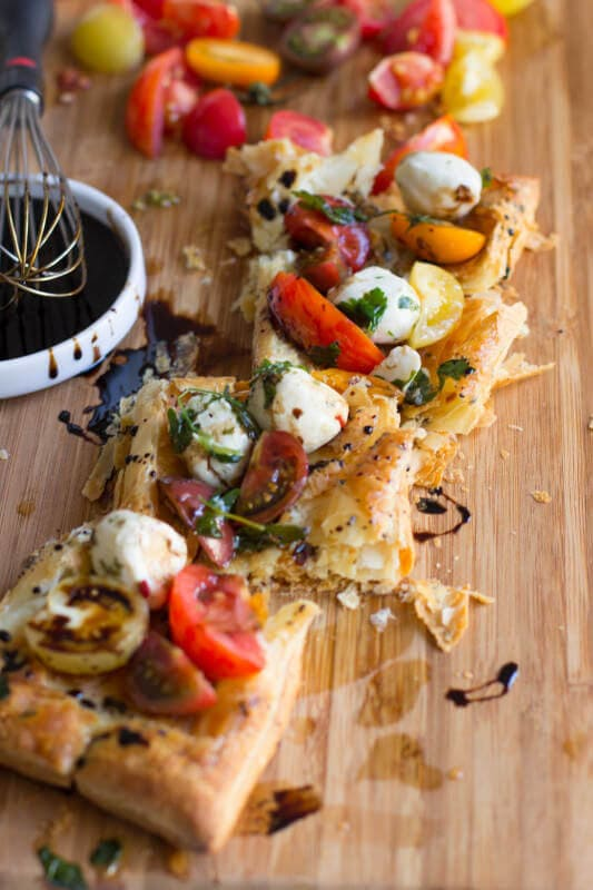 Heriloom tomatoes, puff pastry, marinated mozzarella and balsamic reduction and guess what, all of it is premade and you can whip it all together. ohsweetbasil.com_-3