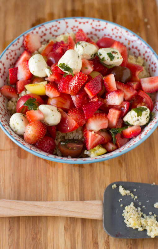 The perfect way to enjoy your summer without gobs of calories, heirloom tomatoes, marinated mozzarella and plump strawberries tossed in quinoa #vegetarian #recipe ohsweetbasil.com heirloom berry quinoa salad