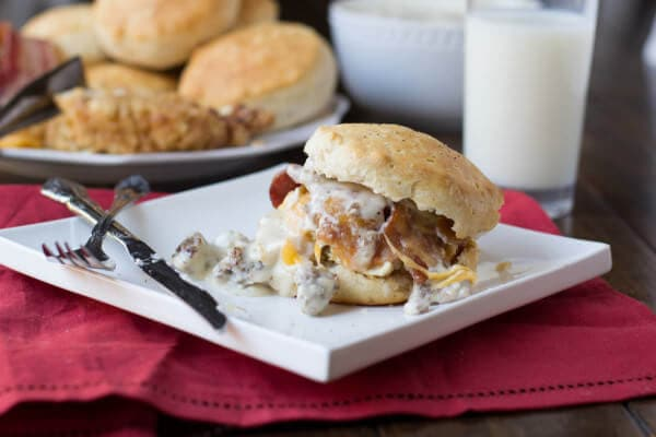 jimmy dean sausage gravy over biscuits, bacon, cheese and fried chicken. HOLY MOLY. ohsweetbasil.com biscuits and gravy sandwich, the heart attack