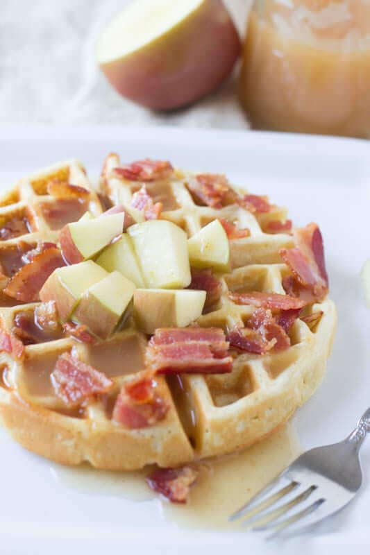 Fluffy waffles filled with sweet apples and crisp bacon are already delicious, but top it with the best apple cider syrup and we are hooked! ohsweetbasil.com