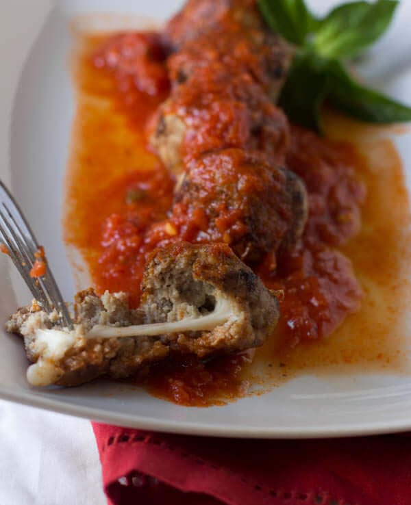 Want an #easy and #healthy #dinner #recipe- We adore these super fast turkey #meatballs stuffed with mozzarella and covered in fresh marinara ohsweetbasil.com Margarita Meatballs