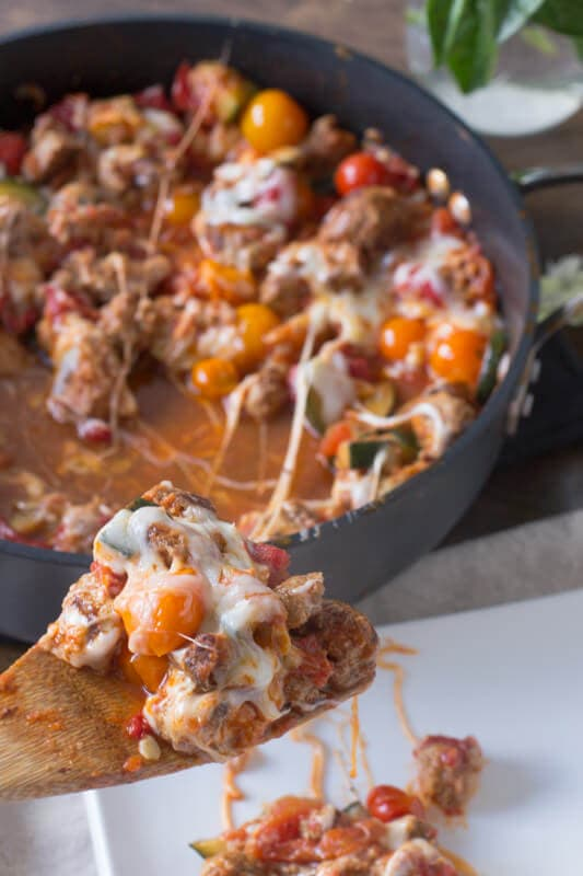 Easy way to use up that bursting garden, a cheesy garden skillet! Plus it can be made with turkey meatballs, #vegetarian for #meatlessmonday or #vegan! ohsweetbasil.com