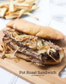 Delicious Pot Roast sandwich on a wooden board.
