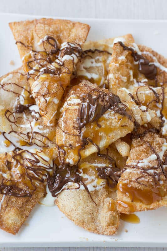 Triple Threat #Nachos, fudge sauce, caramel and marshmallow cream drizzled all over cinnamon sugar crisps. #recipe ohsweetbasil.com_