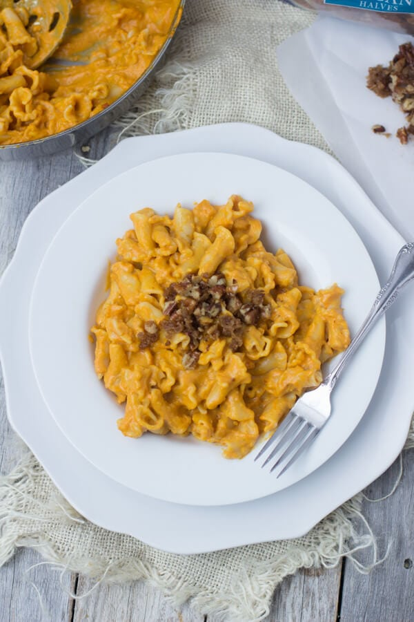 Creamy Pumpkin Pasta sauce with crunchy brown sugar pecans. You have to try to truly understand just how fantastic this pasta dish is! #fishernuts ohsweetbasil.com
