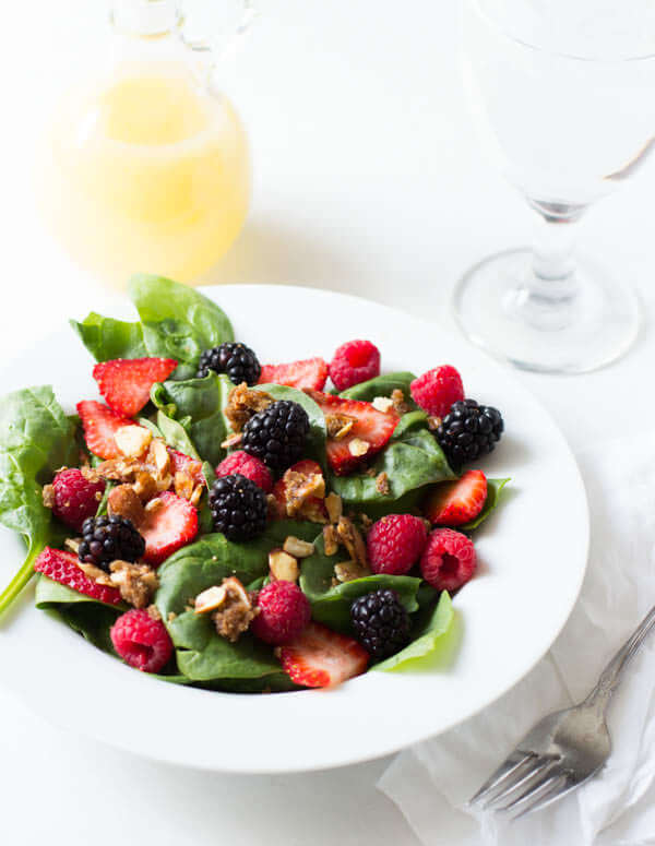 Our favorite #salad #recipe ever! It seems so simple but then when you get that perfect bite with spinach, berry, and brown sugar almonds with a light lemon dressing, good mercy! ohsweetbasil.com_