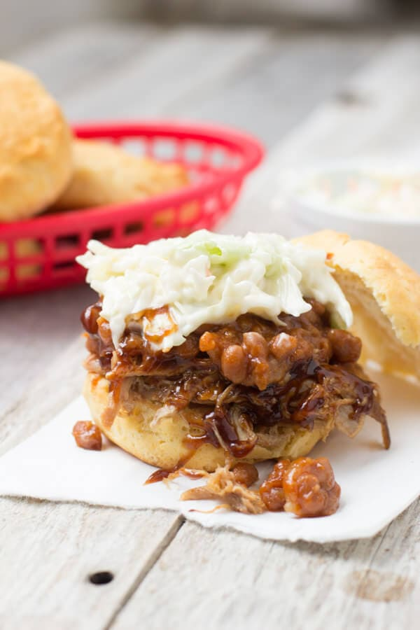 The Tailgator, the ultimate sandwich for a tailgating party. Corn biscuits stuffed with pulled pork, baked beans and coleslaw! ohsweetbasil.com-3