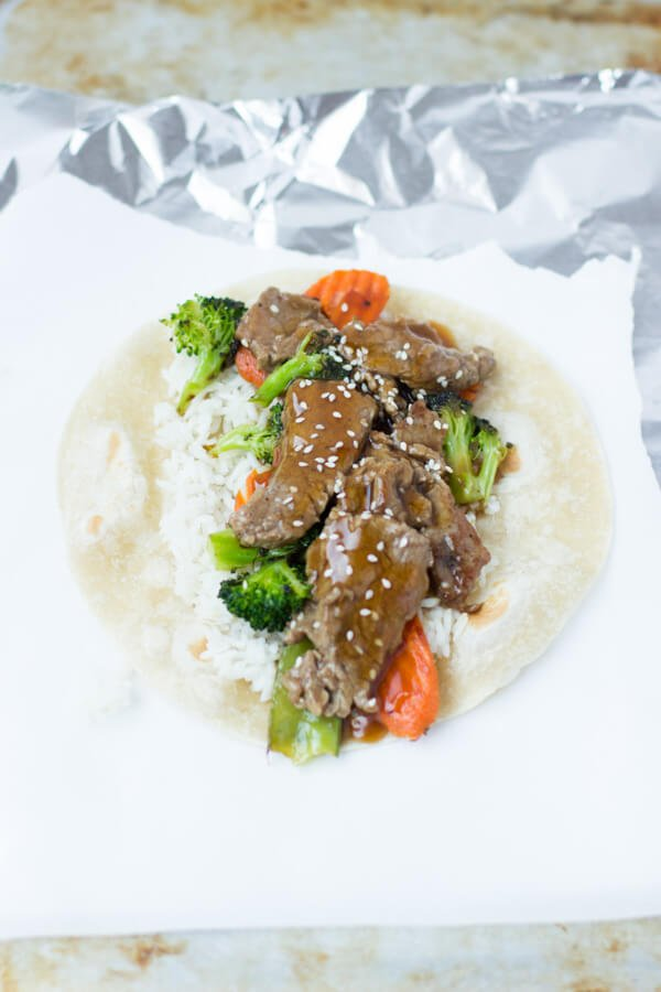 teriyaki beef wrap for a quick dinner! ohsweetbasil.com broccoli, carrots, rice, sesame seeds