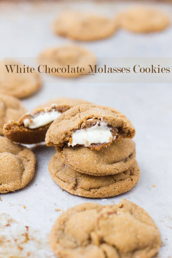 molasses cookies stuffed with creamy white chocolate and rolled in sugar. THe ultimate cookie of the #holidays ohsweetbasil.com